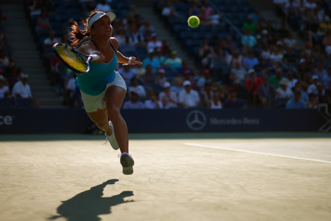 NEW YORK, NY - AUGUST 27: Alexandra Dulgheru of Romania returns a shot against Maria Sharapova of Russia on Day Three of the 2014 US Open at the USTA Billie Jean King National Tennis Center on August 27, 2014 in the Flushing neighborhood of the Queens borough of New York City. (Photo by Mike Stobe/Getty Images for USTA)