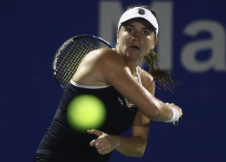 KUALA LUMPUR, MALAYSIA - MARCH 03: Alexandra Dulgheru of Romania plays a shot to Sabine Lisicki of Germany during day two of the BMW Malaysian Open at the Royal Selangor Golf Club Tennis Centre Court on March 3, 2015 in Kuala Lumpur, Malaysia. (Photo by Stanley Chou/Getty Images)