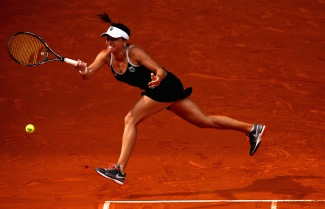 MADRID, SPAIN - MAY 02: Alexandra Dulgheru of Romania plays a forehand against Ana Ivanovic of Serbia in their first round match during day one of the Mutua Madrid Open tennis tournament at the Caja Magica on May 2, 2015 in Madrid, Spain. (Photo by Clive Brunskill/Getty Images)