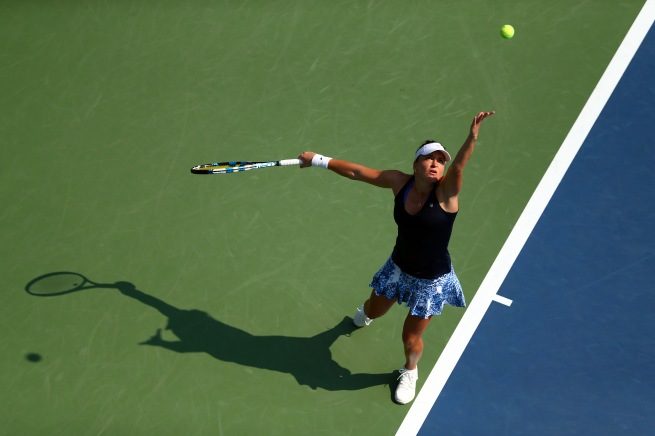 NEW YORK, NY - SEPTEMBER 01: Alexandra Dulgheru of Romania serves against Angelique Kerber of Germany during their Women's Singles First Round match on Day Two of the 2015 US Open at the USTA Billie Jean King National Tennis Center on September 1, 2015 in the Flushing neighborhood of the Queens borough of New York City. (Photo by Clive Brunskill/Getty Images)