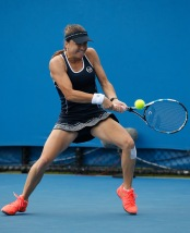 MELBOURNE, AUSTRALIA - JANUARY 19: Alexandra Dulgheru of Romania plays a backhand in her first round match against Storm Sanders of Australia during day two of the 2016 Australian Open at Melbourne Park on January 19, 2016 in Melbourne, Australia. (Photo by Darrian Traynor/Getty Images)