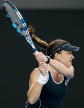 MELBOURNE, AUSTRALIA - JANUARY 21: Alexandra Dulgheru of Romania plays a backhand in her second round match against Angelique Kerber of Germany during day four of the 2016 Australian Open at Melbourne Park on January 21, 2016 in Melbourne, Australia. (Photo by Darrian Traynor/Getty Images)
